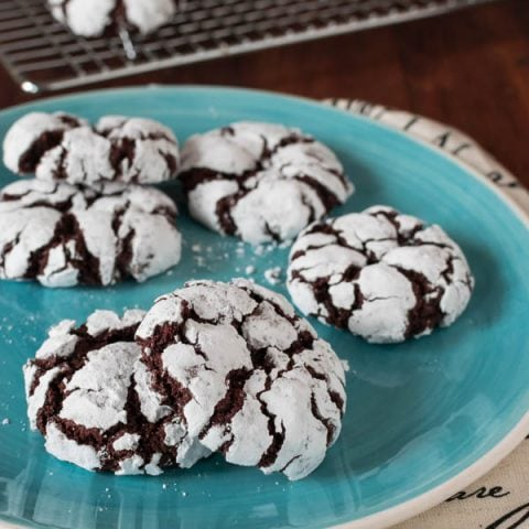 Rolled in powdered sugar, these Fudgy Gluten Free Chocolate Crinkle Cookies are crisp on the outside and soft and chewy on the inside. Who says you can only bake these at Christmas?