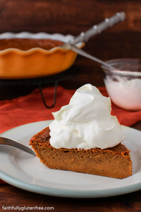 Slice of crustless pumpkin pie topped with whipped cream