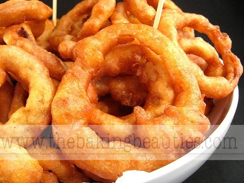 A close up of a bowl of gluten free onion rings.