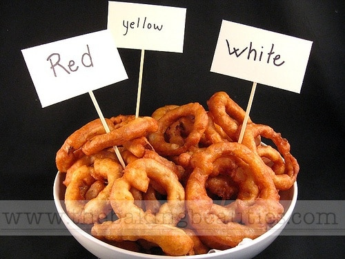 A bowl of gluten free onion rings, comparing how red, yellow & white onions taste.