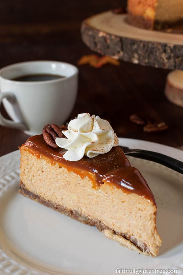 Indulge in this gluten free Pumpkin Cheesecake, with it's velvety texture, warming spices, and nutty crust, everyone is sure to ask for another slice.