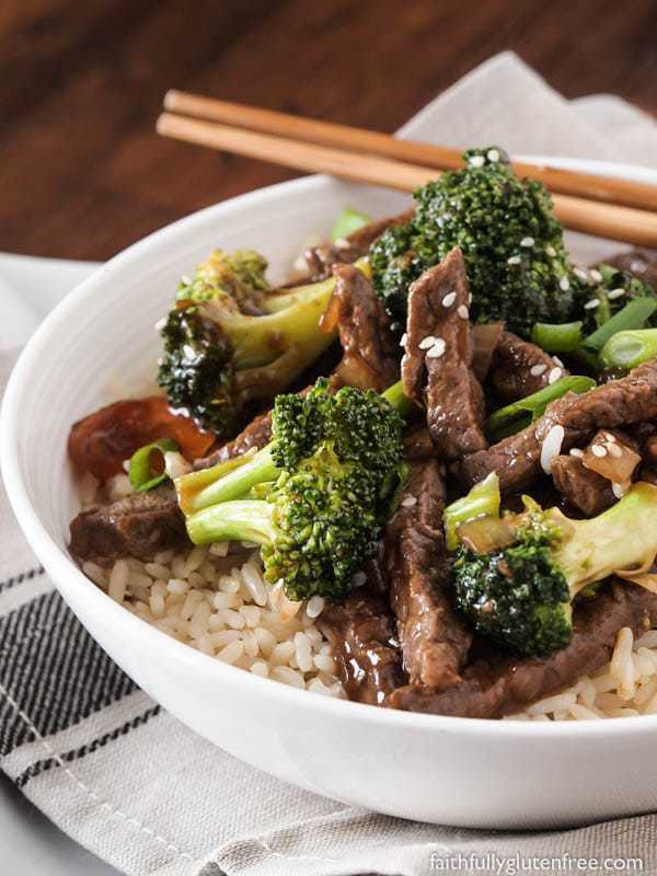 A bowl of rice topped with beef and broccoli stir fry