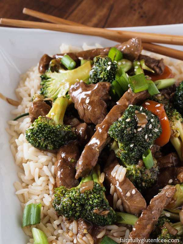 Gluten Free Beef and Broccoli Stir Fry over rice with chopsticks