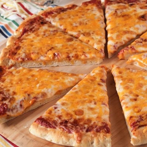 Enjoy pizza night again with this Thick and Chewy Gluten Free Pizza Crust. This crust is soft and chewy, but strong enough to hold up to whatever toppings you put on it.