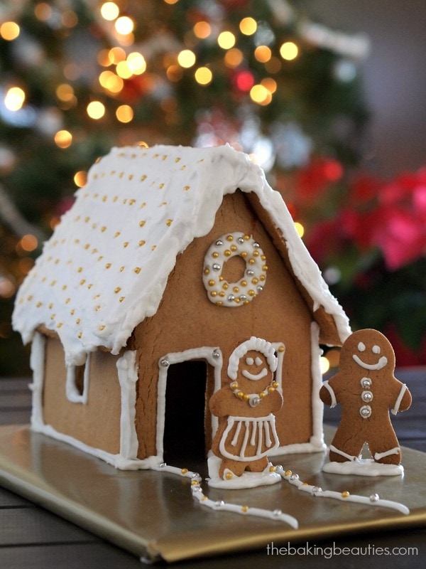 gluten free Gingerbread House decorated in white and gold