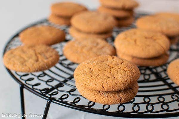 A cooling rack with stacks of ginger snaps