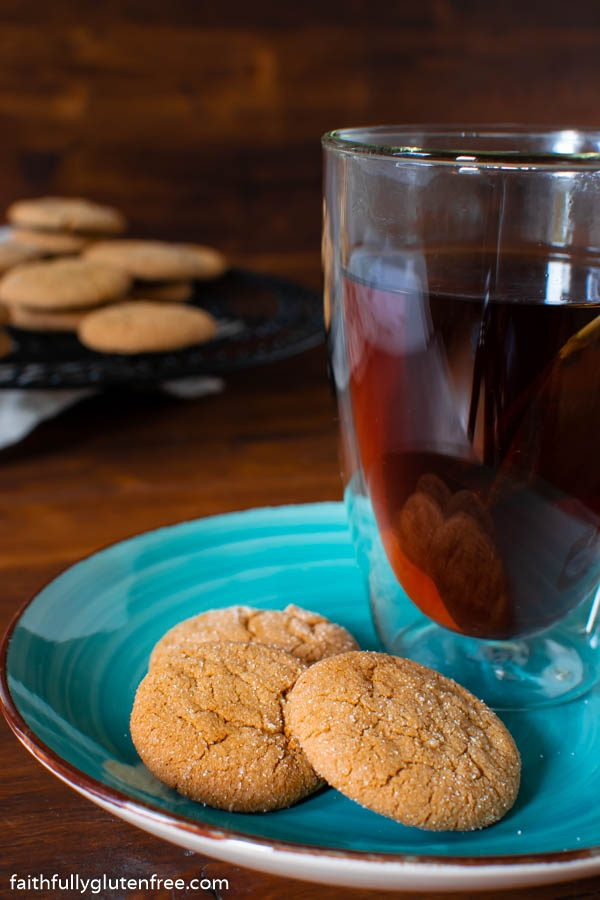 A blue plate holding ginger snap cookies and a cup of tea