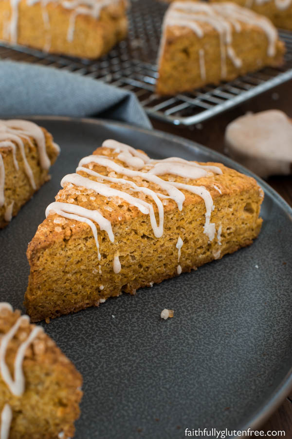 Similar to the seasonal scones offered at Starbucks, these light, fluffy gluten free Pumpkin Scones are filled with pumpkin and warming spices.