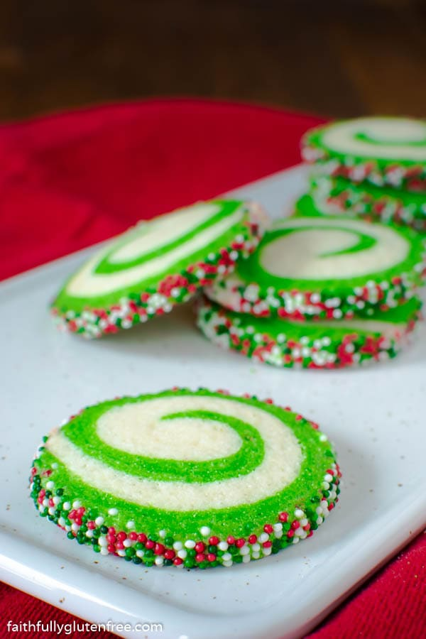 A plate with white and green swirled cookies