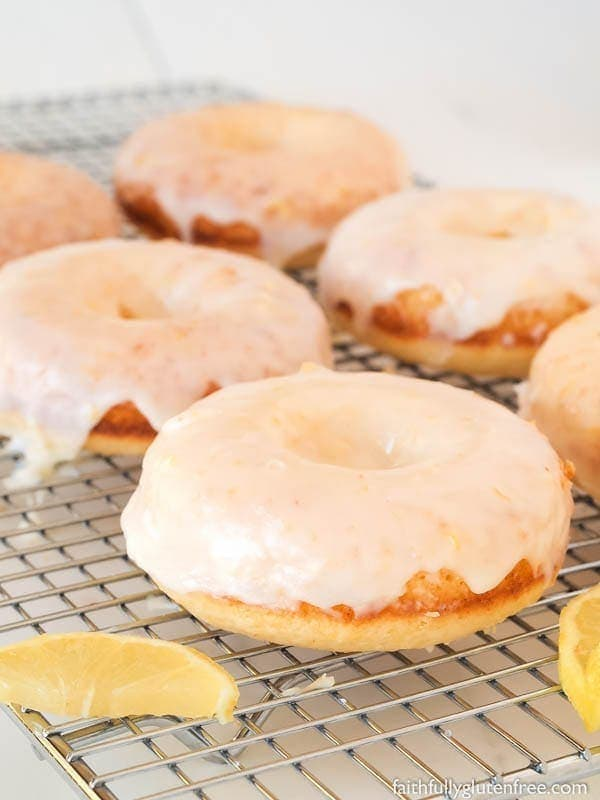 These lighter-than-air Gluten Free Baked Lemon Doughnuts are finished with a glaze and bursting with lemon flavour. On top of that, you can be eating them in less than 30 minutes. Bonus!