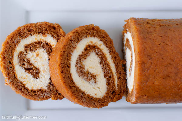 Slices of pumpkin roll cake on a platter