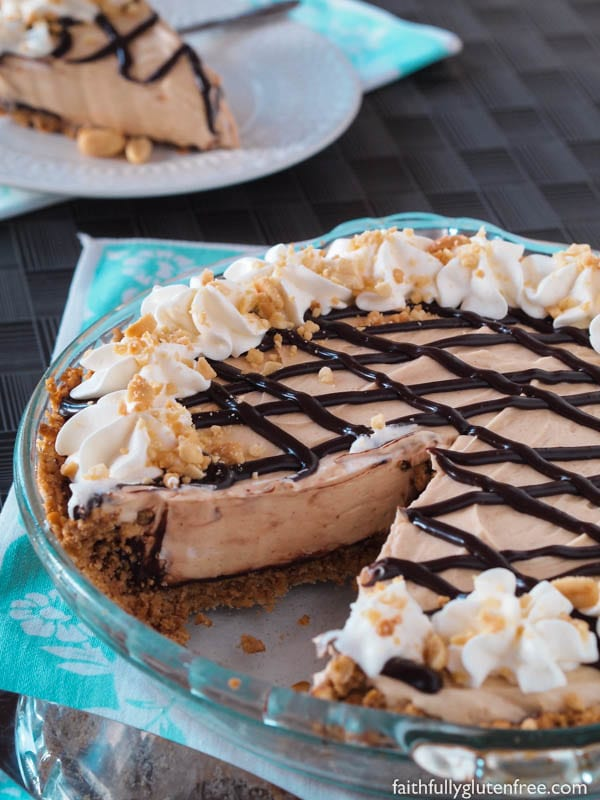 A tall glass of milk or a strong cup of coffee is all that you need to accompany this easy no bake Peanut Butter Pie with Chocolate Covered Pretzel Crust.