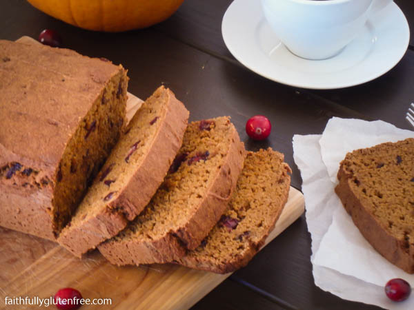slices of pumpkin cranberry loaf on a cutting board