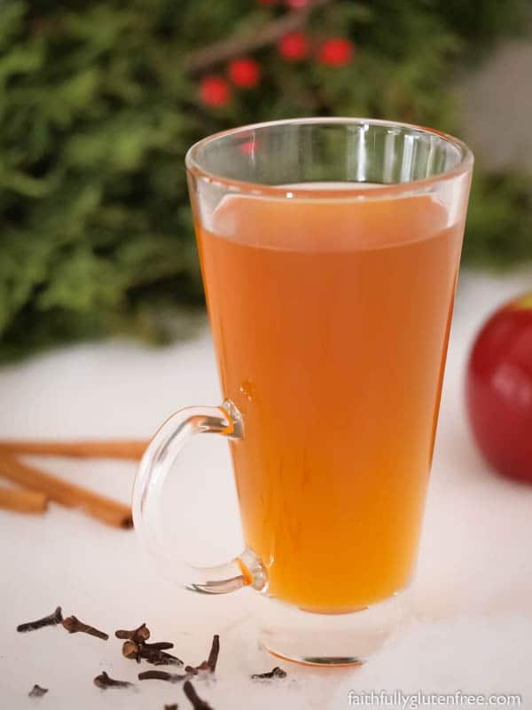 A tall mug of warm Spiced Apple Cider