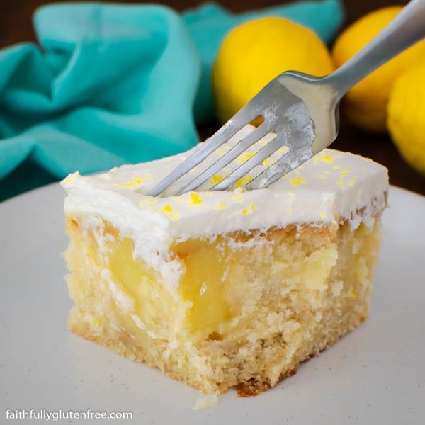 a fork stuck in a piece of lemon poke cake