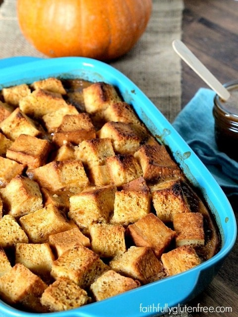Embrace fall with a bowl of warm Gluten Free Pumpkin Bread Pudding drizzled with caramel sauce from Faithfully Gluten Free