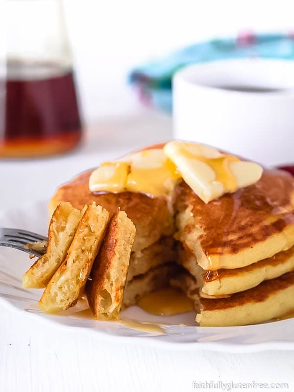 A cut stack of gluten free pancakes
