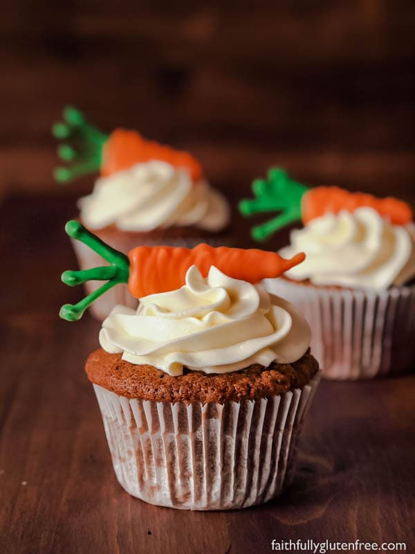 These Gluten Free Carrot Cake Cupcakes are loaded with shredded carrots and warming cinnamon. Topped with the lightest cream cheese frosting, you are going to love them!