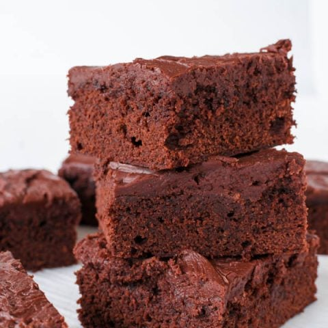 Gluten Free Lunch Lady Brownies are the perfect combination of cakey and fudgy brownies, and the frosting is out of the is world. Being the Lunch Lady can't have been a bad gig when you were serving up these treats.