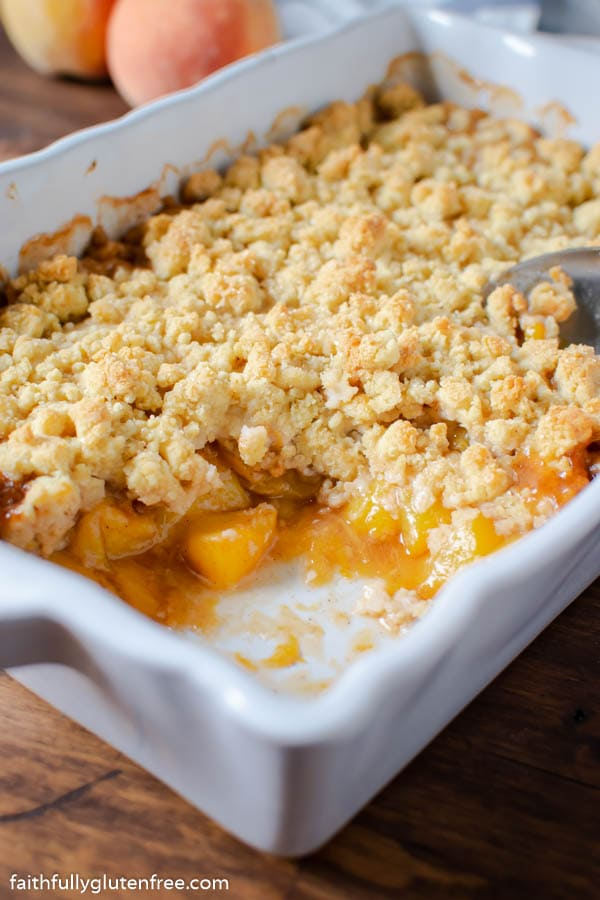 a baking dish of fresh peach cobbler