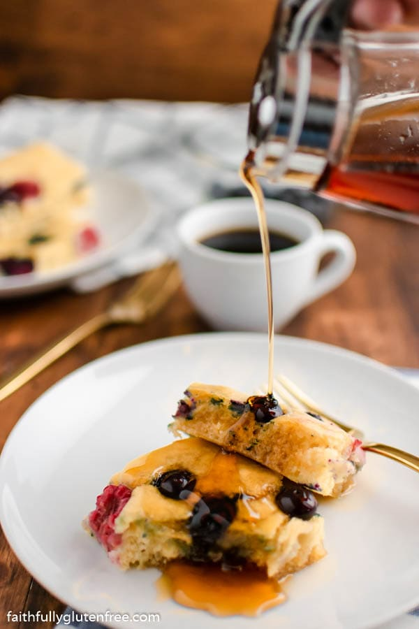Sheet Pan Pancakes being drizzled with syrup