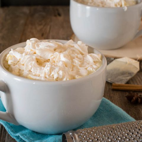 Large mugs of hot chocolate topped with whipped cream