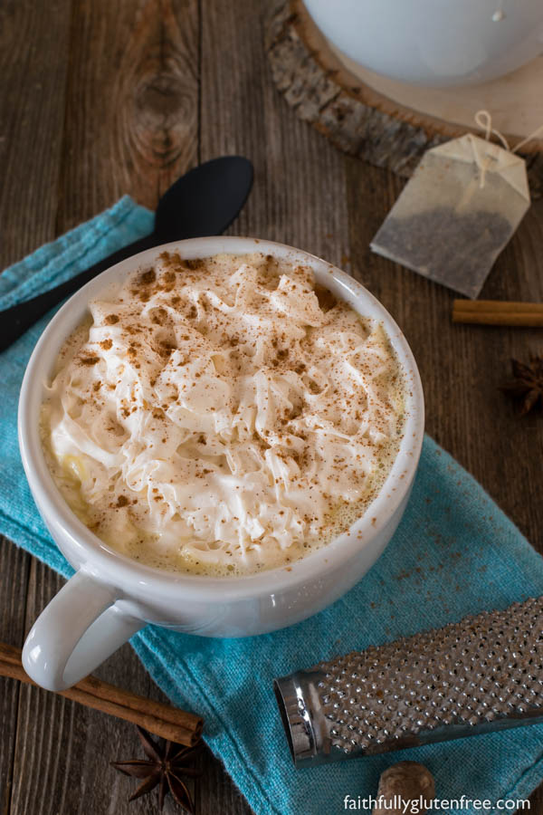 A large cup of hot chocolate topped with whipped cream and cinnamon