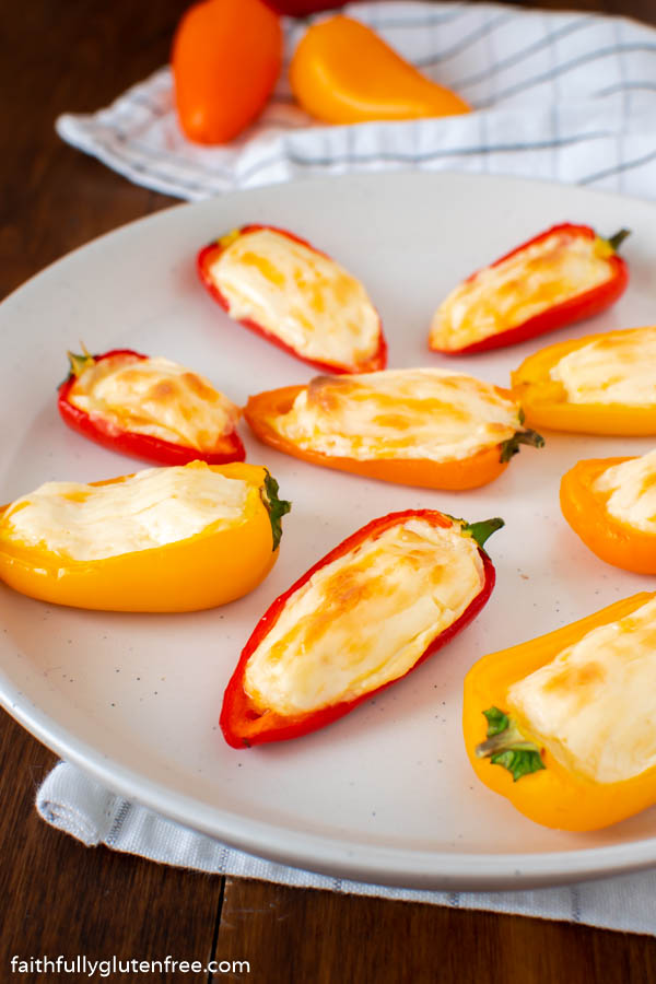 a plate of cheese stuffed mini sweet peppers