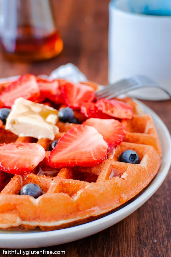 a waffle topped with strawberries and blueberries