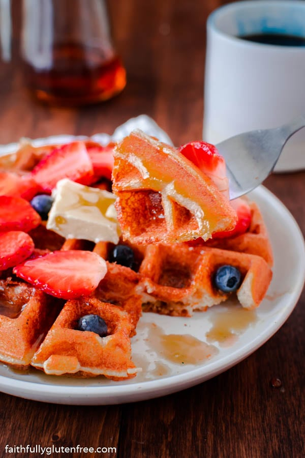 eating a Belgian waffle with strawberries and blueberries